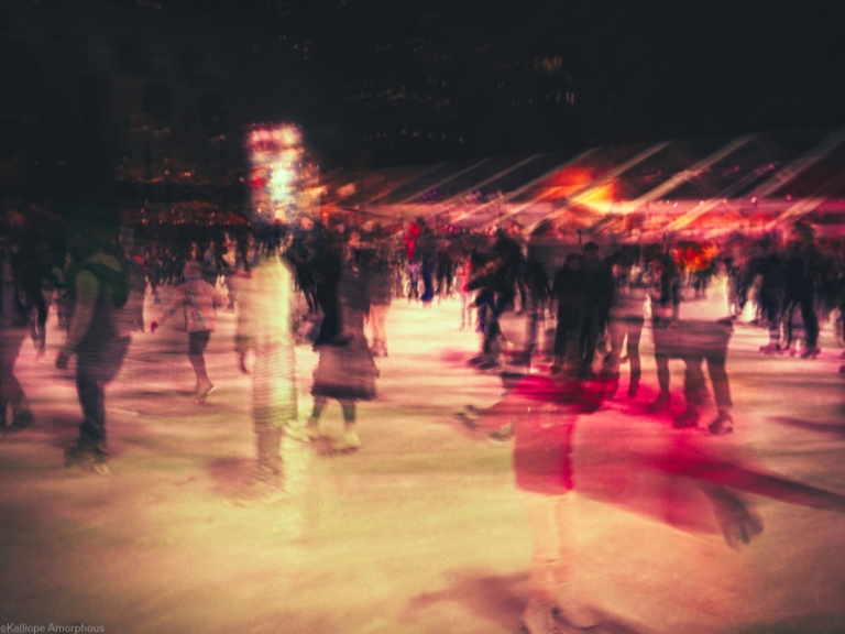 skaters in bryant park nyc long exposure